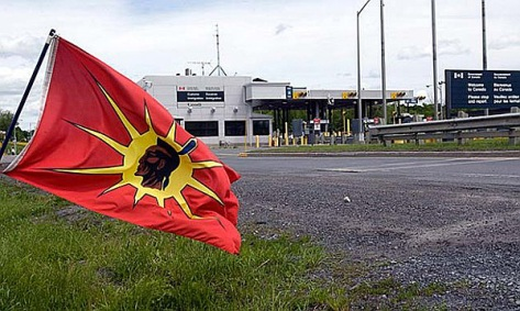 A Mohawk Warrior flag flies in front of a Canadian border crossing station