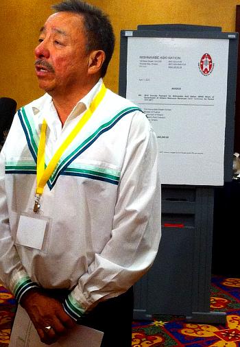 NAN Grand Chief Stan Beardy, with 'invoice' (Wawatay News)