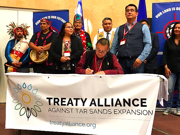 Anti-pipeline Treaty signing (Lasia Kretzel, NEWS 1130 Photo)